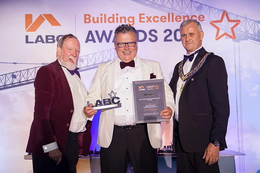 Winner on stage at the LABC West Midlands Building Excellence Awards 2019