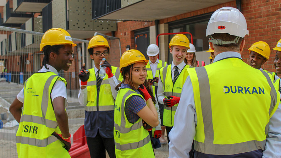 Young people learning on a construction site - Construction Youth Trust