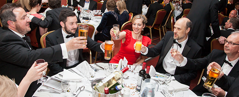 Attendees raising their glasses at the LABC awards night