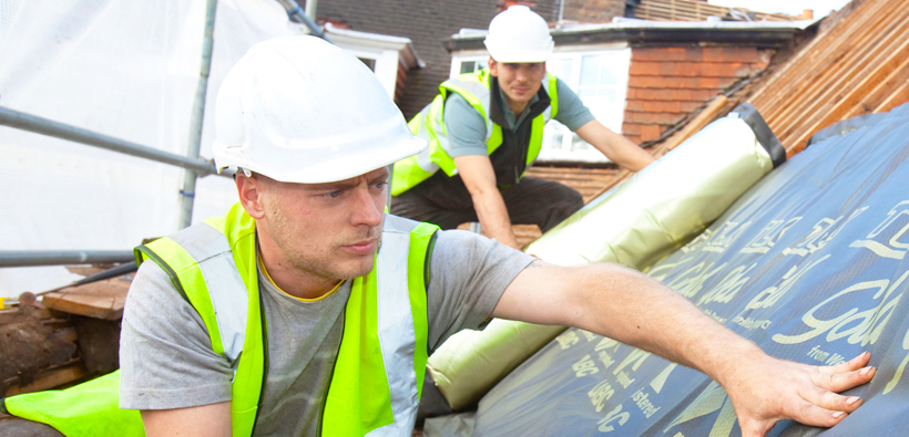 Roofer working on roof - competent persons scheme