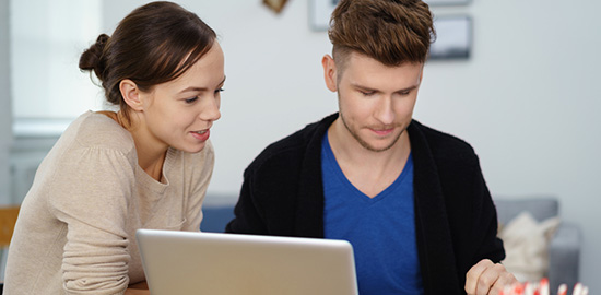 Couple at laptop - online building control application