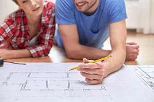 Couple looking at house plans - house project
