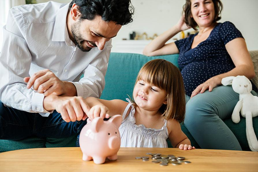 Family living in an energy efficient home with a piggy bank saving money