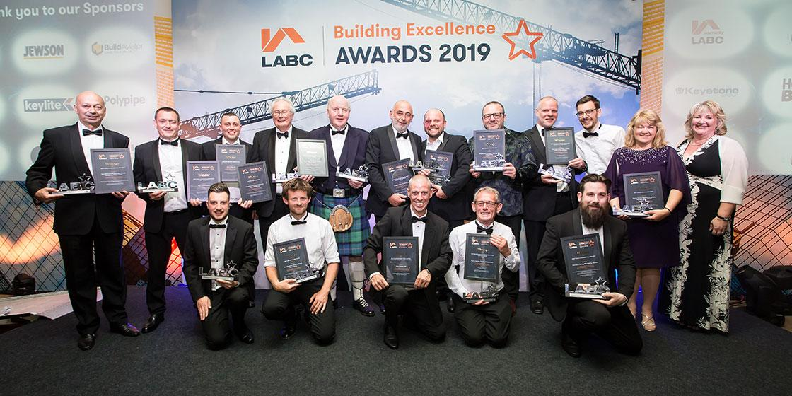Winners on stage at the LABC South West Building Excellence Awards 2019
