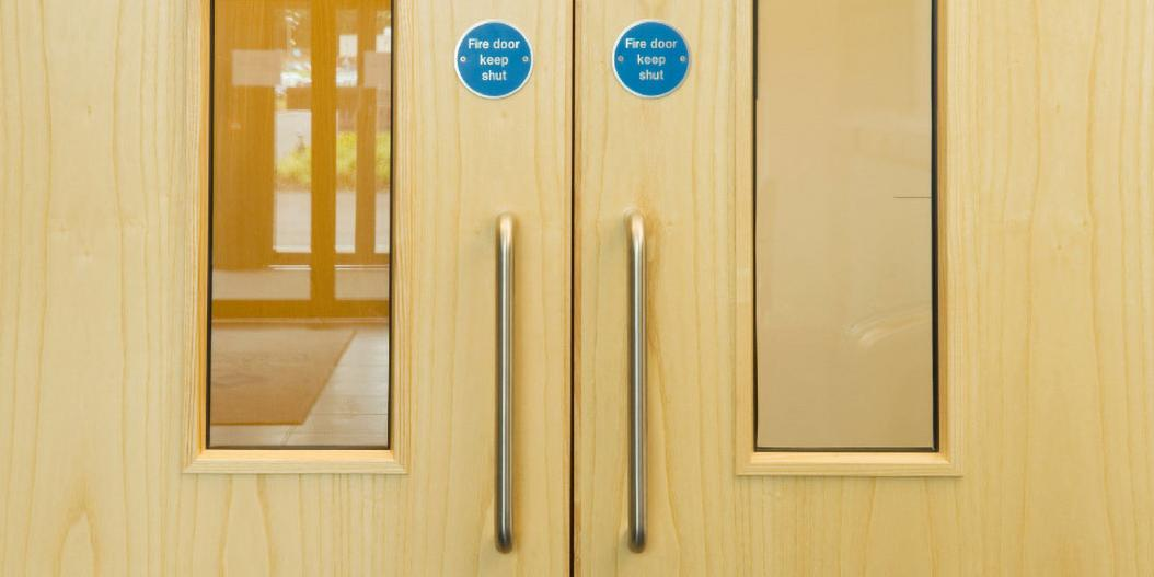 Fire doors with blue signs - Fire door keep shut