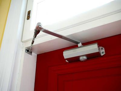 Fire door closer - red fire door