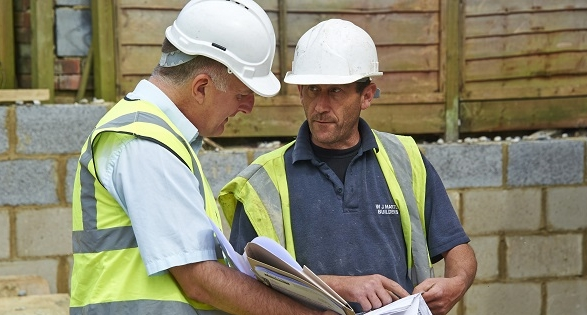 Two men on building site in hard hats - LABC Partner Authority Scheme