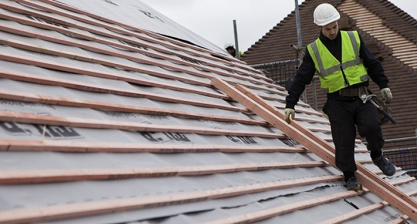 Picture of roofer on roof